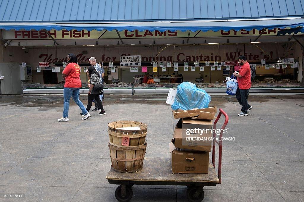 People visit the maine avenue fish market along the for Washington dc fish market