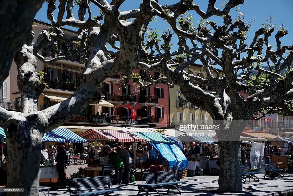 People visit the market in the town of Ascona on Lago Maggiore also called Lake Langen on May 24, 2016. The German national football team will train here from May 24 until June 3, 2016 for the EURO 2016 taking place in France. / AFP / PATRIK