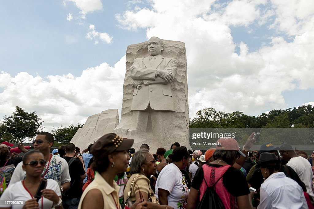 People visit the Martin Luther King Jr. Memorial to celebrate the 50th anniversary of the March on Washington and Dr. Martin Luther King, Jr.'s 'I have a Dream' speech on the National Mall on August 24, 2013 in Washington, DC. A commemorative march and a rally along the historic route followed in 1963 is led by civil rights leaders Al Sharpton and Martin Luther King III.