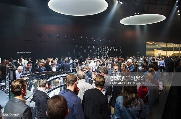 People visit the Mercedes pavilion at the 66th IAA auto show in Frankfurt on September 17 2015 Hundreds of thousands of visitors are expected to...