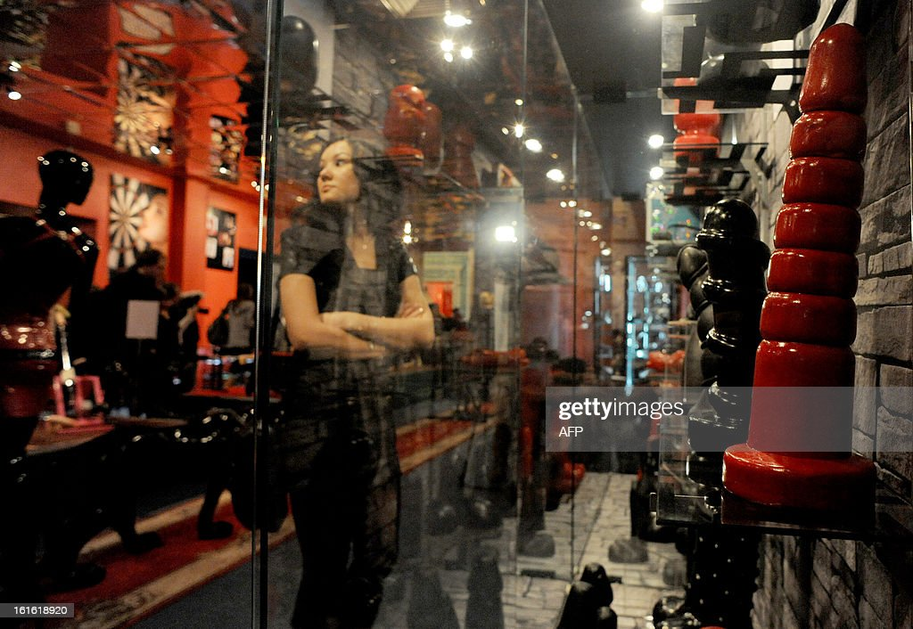 People visit the 'MuzEros', an erotic museum, shortly after its opening in Russia's second city of St. Petersburg on February 13, 2013. The museum exhibits a collection of sexual artifacts from around the world, the museum organizers said.