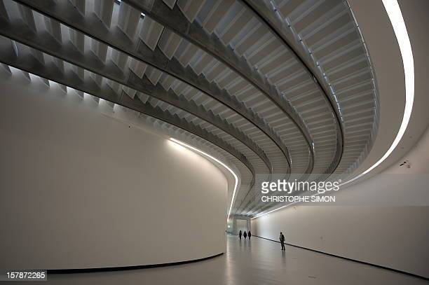 People visit the National Museum of the XXI Century Arts the Maxxi during the architectural preview on the occasion of the completion of the building...