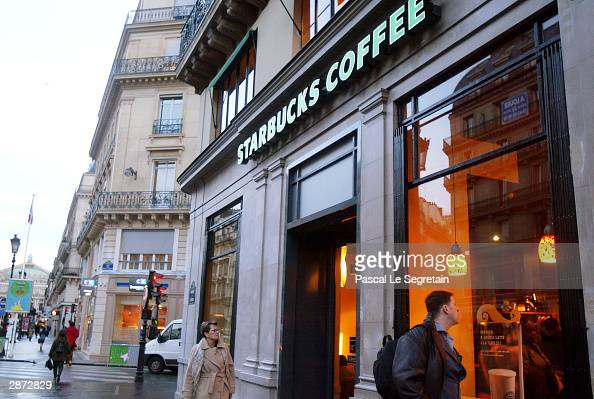 People visit the new Starbucks store the first ever in France as it opened for the public January 16 2004 in Paris Almost six years after it began...