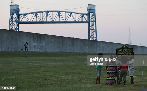 People visit the newly erected historic marker at the site where the Lower Ninth Ward levee failed on August 27 2015 in New Orleans Louisiana The new...