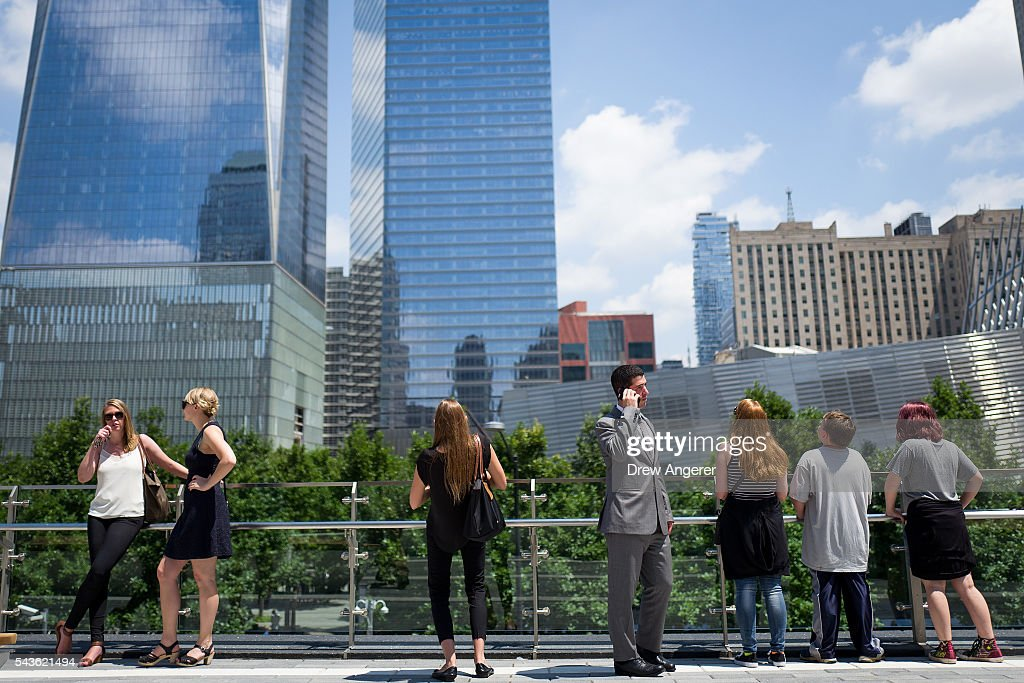 People visit the newly opened Liberty Park in Lower Manhattan, June 29, 2016 in New York City. Liberty Park, elevated above Liberty Street in Lower Manhattan, overlooks the National September 11 Memorial Plaza and One World Trade Center. The one-acre, $50 million park will be open to the public every day from 6 in the morning to 11 at night.