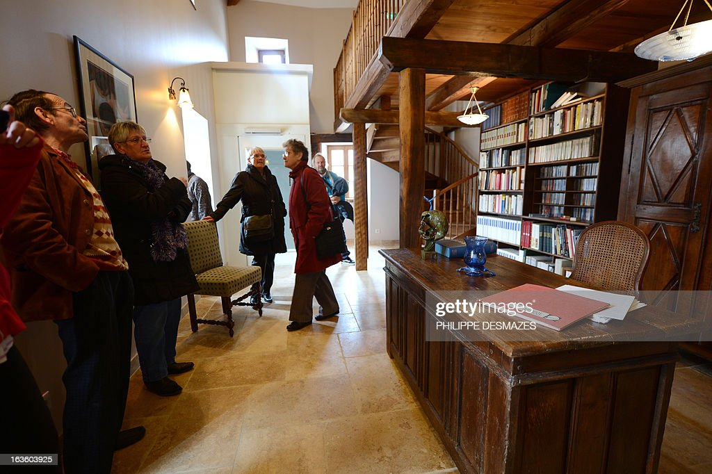 People visit the office room at the 'Maison Jean Ferrat' in the southern French city of Antraigues-sur-Volane, on March 13, 2013, during its opening three years after French singer-songwriter Jean Ferrat died. As prolific as he was discreet, Ferrat wrote and performed about 200 songs which reflected his political views, his affection for the poet and novelist Louis Aragon, and his love for his adopted Ardeche region.