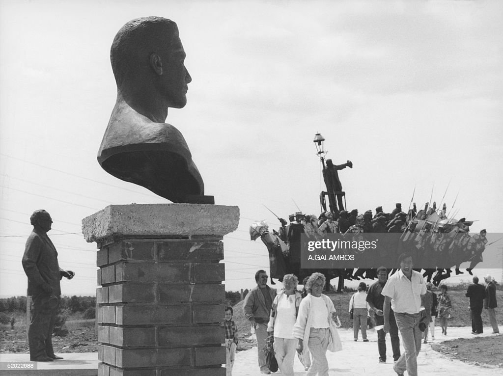 People visit the open-air permanent art exhibit in Budapest, where the bust of BTla Kun (foreground), a sculpture featuring the 1919 'Commune' uprising (R-background) and the sculpture of left-wing Social Democratic leader Arpad Szakasits, are on display, end of July 1993. The show served as a memento of a 45-year period, presenting the monuments connected with the former communist era. BTla Kun (1886-1939), Hungarian communist leader, joined Russian Bolsheviks in 1916 and set up in 1919 in Hungary a Soviet republic that lasted 5 months. After his regime was overthrown, Kun returned to Russia and was killed in one of the Stalinist purges in the late 1930's.