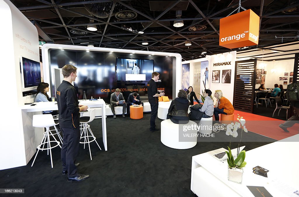 People visit the 'Orange' stand at the MIPTV one of the world's largest broadcasting and audio-visual trade show, on April 10, 2013 in Cannes, southeastern France .