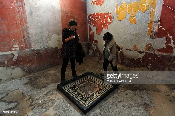 People visit the Pacuius Proculus Domus one of six restored domus at UN World Heritage Site Pompeii on December 24 2015 during the official opening...