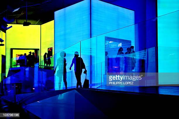 People visit the pavilion of Slovenia at the site of the World Expo 2010 in Shanghai on late August 8 2010 Shanghai keen to show the world it is a...