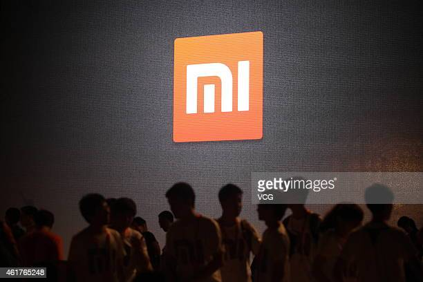 People visit the press conference for Xiaomi 2 smartphone at 798 DPARK on August 16 2012 in Beijing China Hugo Barra vice president of product...