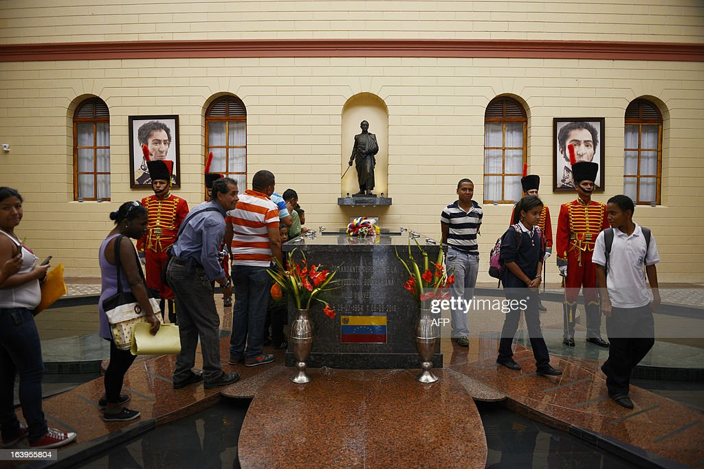 People visit the remains of late Venezuelan President Hugo Chavez at the 'Quarter of the Mountain' in the 23 de Enero Chavez bastion, in Caracas, on March 18, 2013. The 'Quarter of the Mountain', where the body of Chavez lies, while deciding on its transfer to the National Pantheon, is a former barracks that was the center of operations of the failed coup led by Chavez on February 4, 1992.