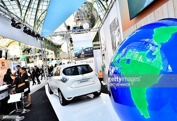 People visit the Renault stand at the 'Solutions COP21' exhibition at the Grand Palais in Paris on December 4 2015 on the sidelines of the COP21...