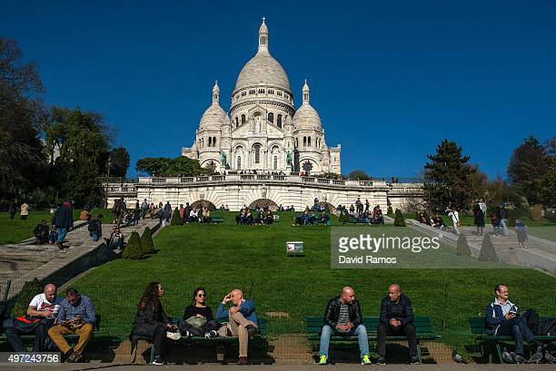 People visit the 'SacreCoeur' cathedral on November 15 2015 in Paris France As France observes three days of national mourning members of the public...
