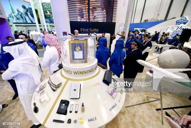 People visit the Saudi Arabia Airlines stand during the Arabian Travel Market 2017 at the Dubai World Trade Centre on April 24 2017 / AFP PHOTO /...