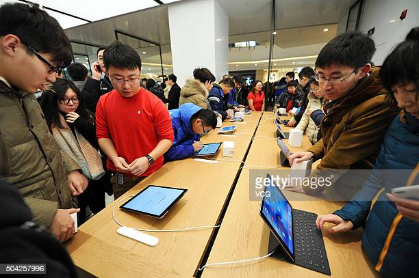 People visit the second Apple store in Shenyang on January 9 2016 in Shenyang Liaoning Province of China 6 revolving glass doors were set in the new...