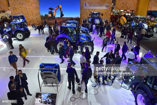 People visit the SIMA Paris International agribusiness show at the Parc des Expositions Paris Nord in Villepinte on February 26 2017 / AFP /...