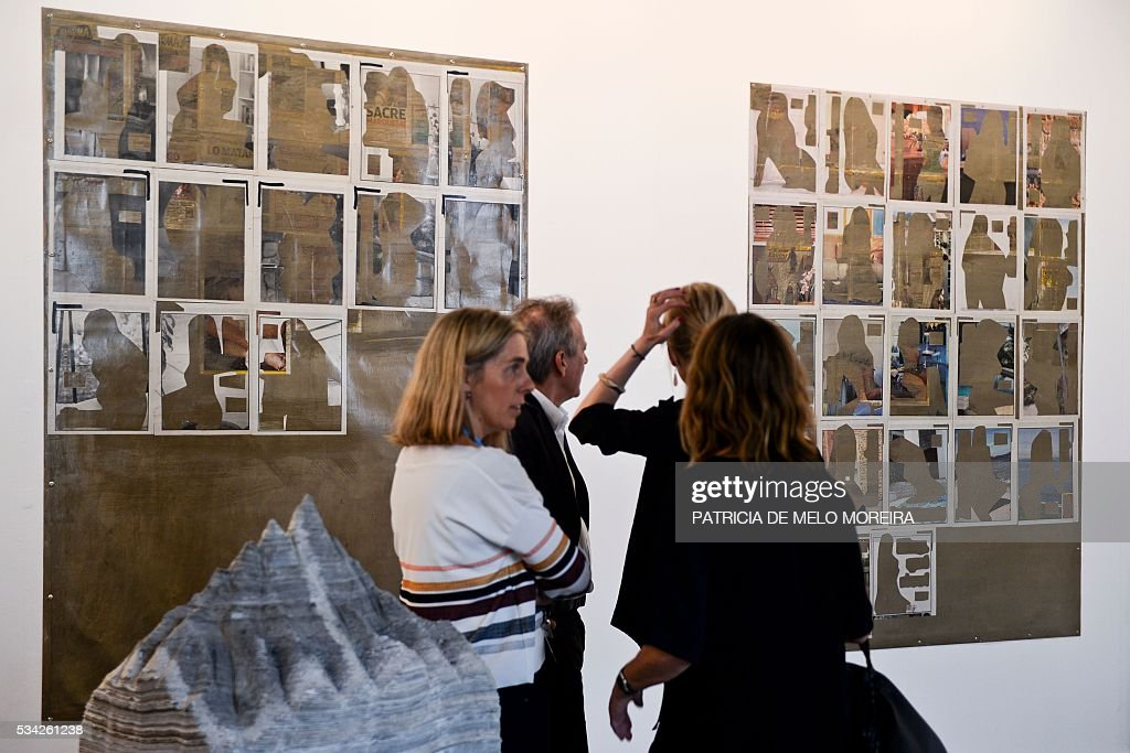 People visit the Spanish gallery 'NF Moris' stand during the ARCO Lisbon Contemporary Art Fair in Lisbon on May 25, 2016. ARCO will be open to the public from May 26 to 29. / AFP / PATRICIA