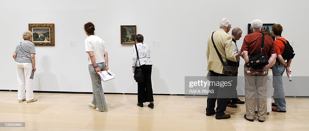 People visit the temporary exhibition 'Henri Rousseau' at the Guggenheim Bilbao museum on May 25, 2010, in the Northern Spanish Basque city of Bilbao. The exhibition, opened from May 25 untill September 12, 2010, includes thirty masterpieces providing a review of the French painter's career.