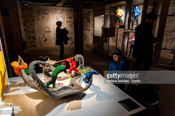 People visit the 'The Art of the Brick DC Super Heroes' Exhibition at the Palace of Exams on November 30 2017 in Rome Italy The exhibition called...
