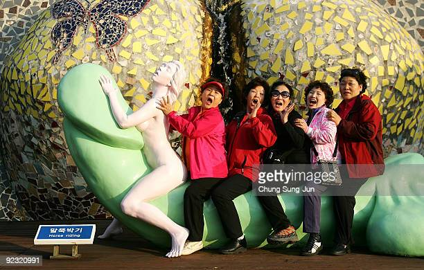 People visit the theme park 'Love Land' on October 24 2009 in Jeju South Korea Love Land is an outdoor sexthemed sculpture park which opened in 2004...