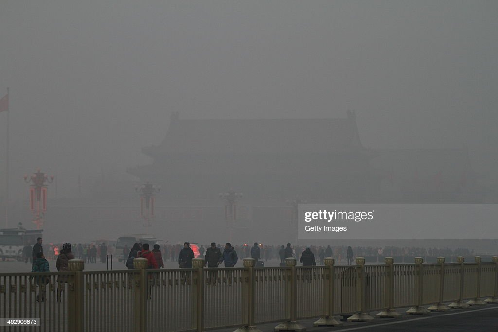 People visit the Tiananmen Square which is shrouded with heavy smog on January 16, 2014 in Beijing, China. Beijing Municipal Government issued a yellow smog alert this morning.