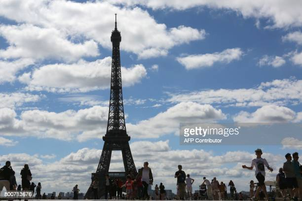 People visit the Trocadero esplanade in front of the Eiffel tower on June 25 in Paris / AFP PHOTO / LUDOVIC MARIN