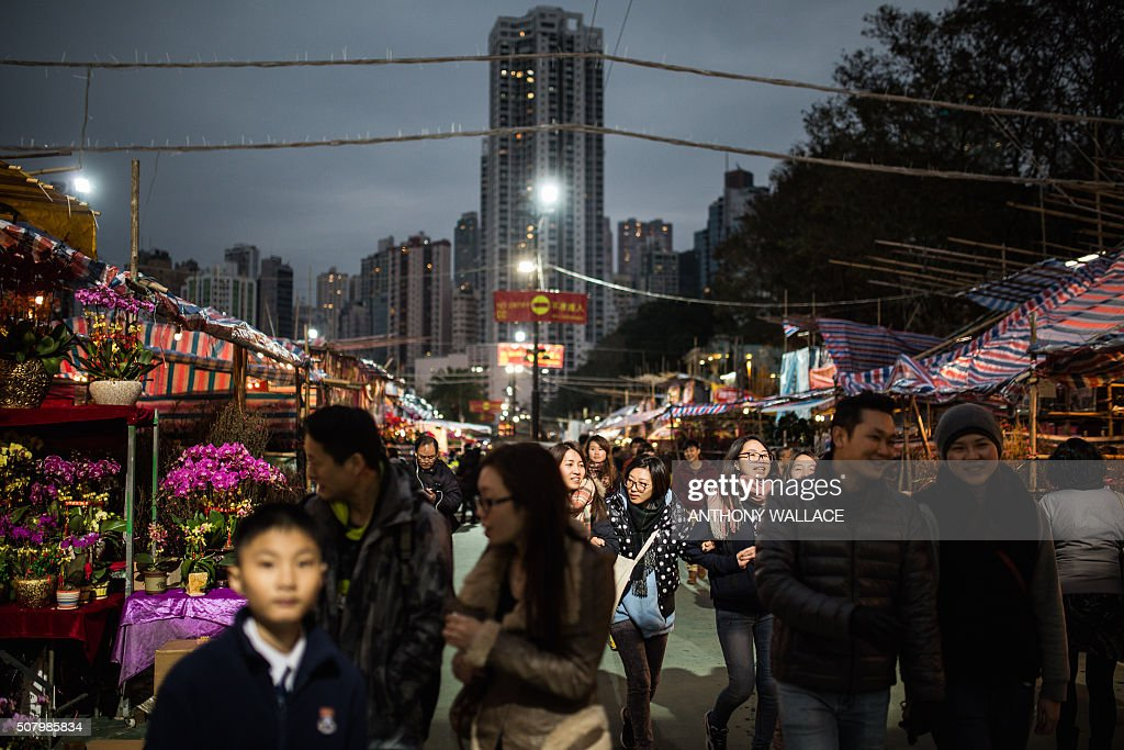 People visit the Victoria Park New Year Flower Market in Hong Kong on February 2 ahead of the Chinese Lunar New Year According to the Chinese zodiac...