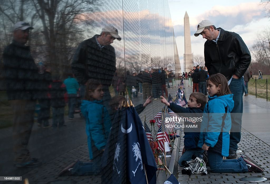 People visit the Vietnam Veterans Memorial in Washington on March 29, 2013 as the US marks the 40th anniversary of the withdrawal of its last combat troops from South Vietnam. Over 58,000 Americans lost their lives during the Vietnam war. AFP PHOTO/Nicholas KAMM