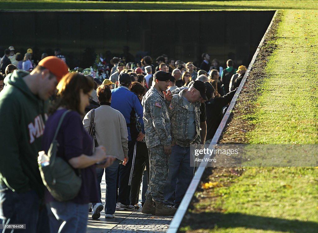 People visit the Vietnam Veterans Memorial on November 11, 2010 in Washington, DC. The nation's veterans were honored and remembered during the annual Veterans Day.