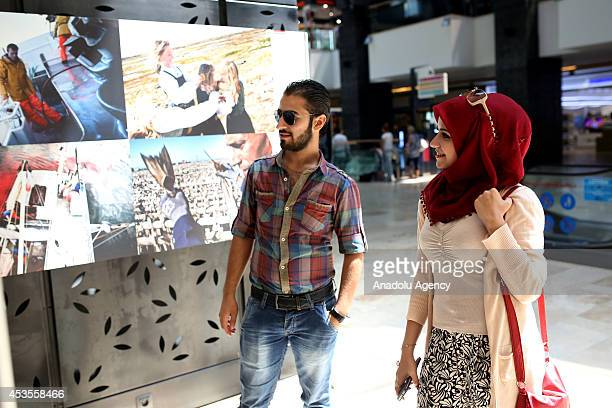 People visit the World Press Photo 2014 exhibition displaying award winning snapshots of photojournalists from around the world at Forum Istanbul...