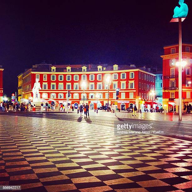 People Visiting At Illuminated Place Massena