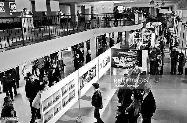 People visiting Montreal's Wolrd Press Photo annual exhibition