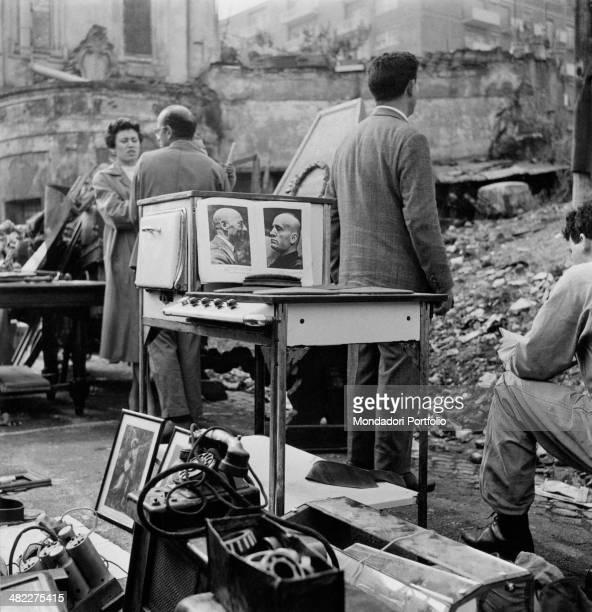 People visiting the Porta Portese flea market Rome 19th December 1959