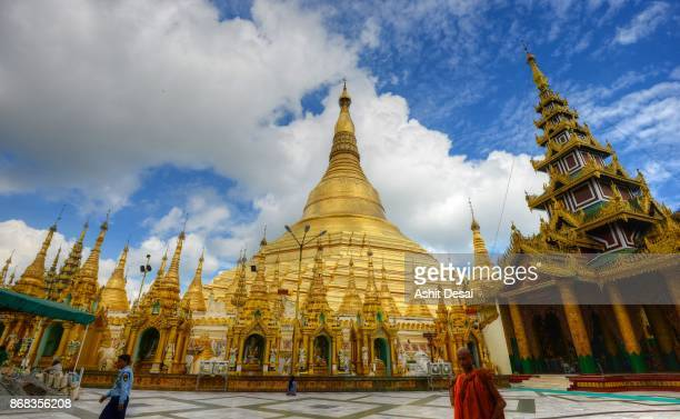 People visiting the Shwedagon Pagoda in Yangon to pray at the most sacred Buddhist site in Myanmar.