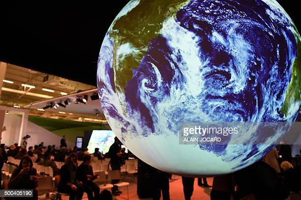 People visits the American stand displayed at the COP 21 the United Nations conference on climate change at Le Bourget on the outskirts of Paris on...