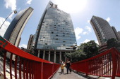 People voluntarily leave the Tower of David an abandoned skyscraper in Caracas originally intended to be an office building that became a 'vertical...