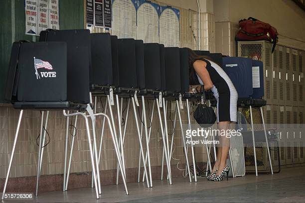 People vote at a fire station on March 15 2016 in Miami Florida Voters cast ballots in the presidential primary in Illinois Missouri North Carolina...