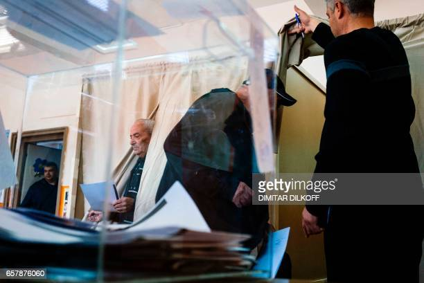 People vote at a polling station in Sofia on March 26 during the country's parliamentary election Bulgaria's election is expected to be a tight race...