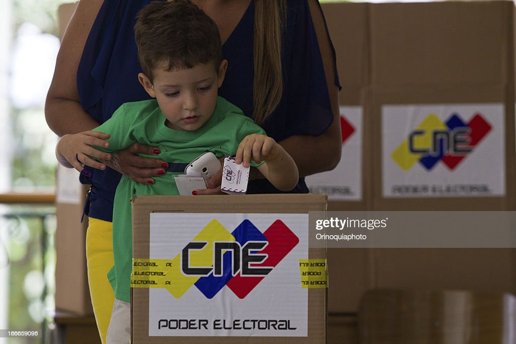 People vote at a voting center at the east of the city, in Santa Rosa de Lima School, during the presidential elections on April 14, 2013 in Caracas, Venezuela.