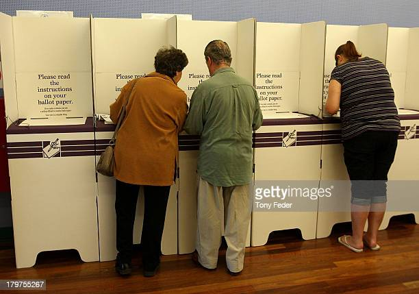 People vote at Blue Haven polling booth in the electorate of Dobell on election day on September 7 2013 in Gosford Australia Voters head to the polls...