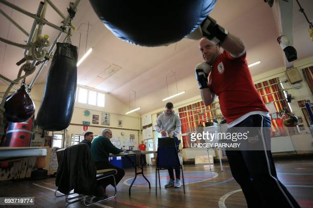 People vote at the East Hull Boxing Club set up as a polling station in KingstonUponHull northern England on June 8 2017 as Britain votes in the...