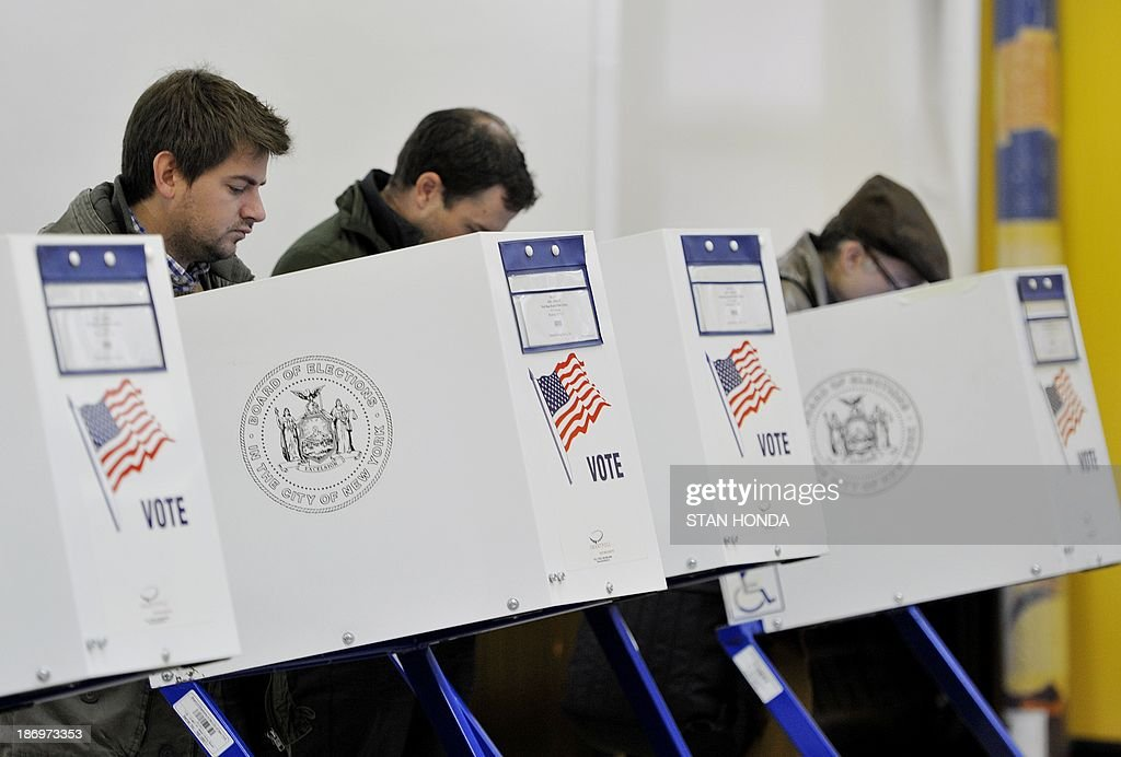 People vote at the Park Slope Branch Public Library in the Brooklyn borough of New York November 5, 2013. AFP PHOTO/Stan HONDA