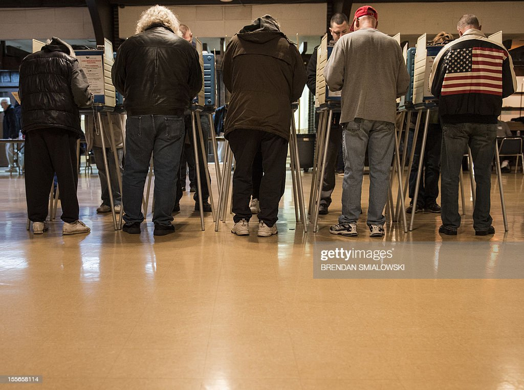 People vote at the United Auto Workers Local 1250 Hall during election day November 6 2012 in Cleveland Ohio Citizens around the United States head...