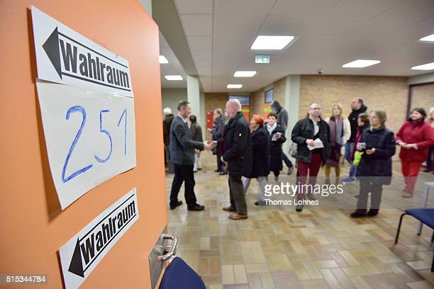 People vote for the RhinelandPalatinate state elections at a polling station on March 13 2016 in Bad Kreuznach Germany State elections taking place...