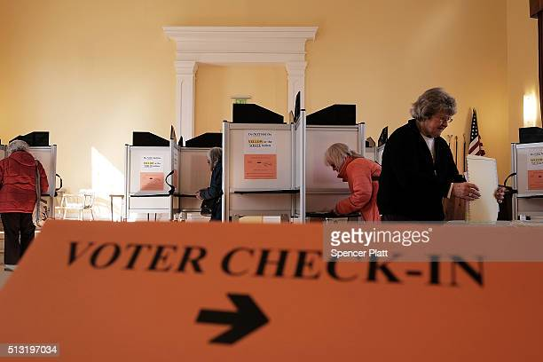 People vote in a church being used as a polling station on March 1 2016 in Ferrisburgh Vermont Thousands of Americans across the country are...