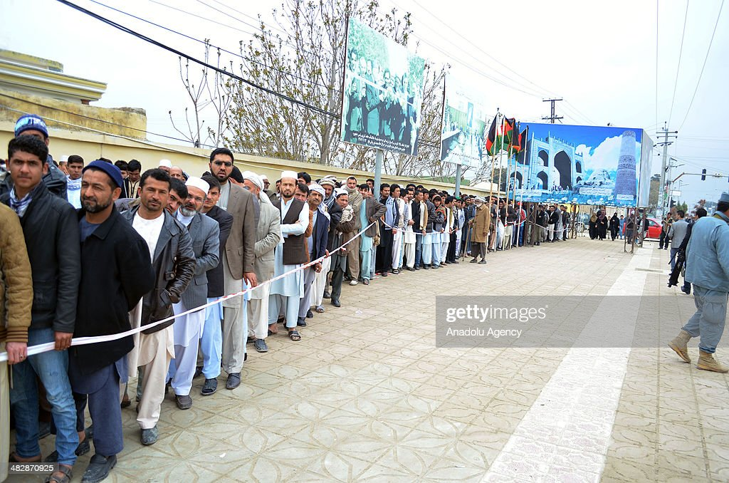 People vote in order to specify the president in Balkh Afghanistan on April 5 2014 Voters queued up to vote from the morning many people left the...