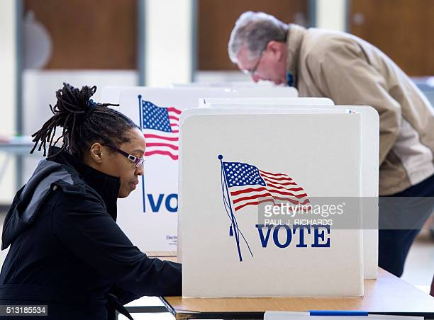 People vote in the Super Tuesday primary at Centreville High School March 1 in Centreville Virginia Voters in a dozen states will take part in 'Super...
