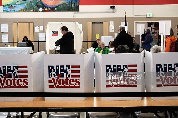 People vote inside of a middle school serving as a voting station on the day of the New Hampshire Primary on February 9 2016 in Bow New Hampshire...