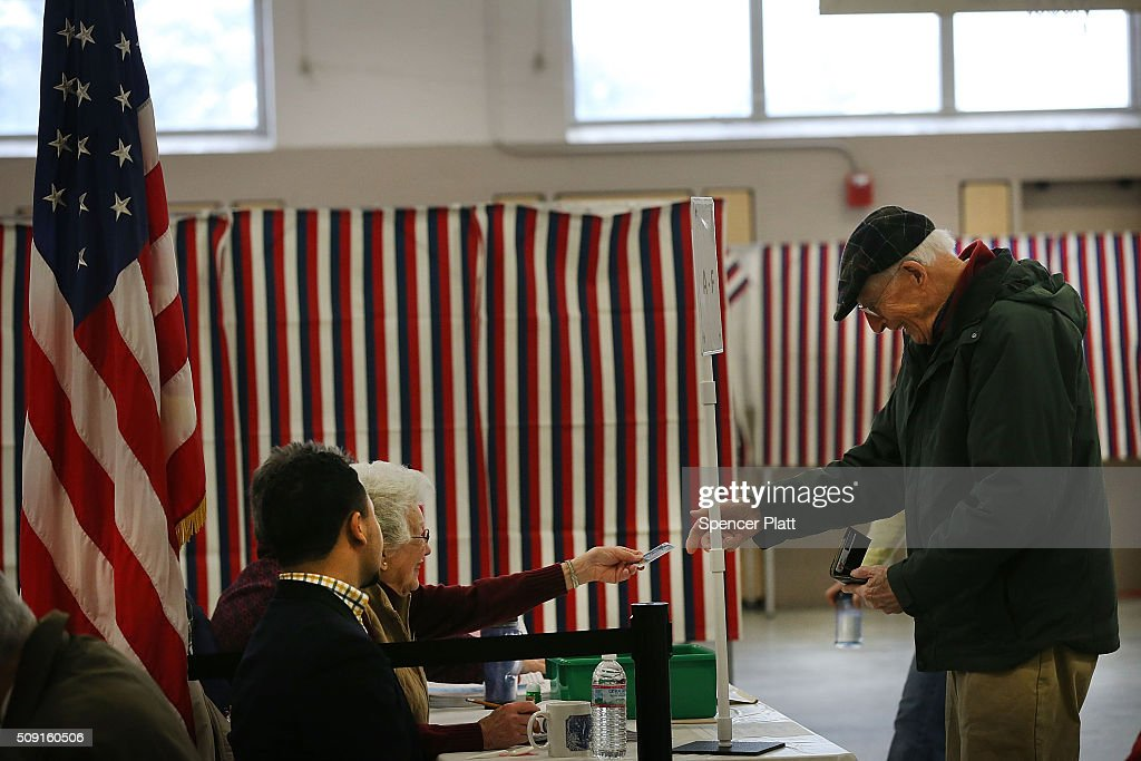 People vote inside of a middle school serving as a voting station on the day of the New Hampshire Primary on February 9, 2016 in Bow, New Hampshire. After months of campaigning, voters across New Hampshire get to go to the polls today to vote for Democratic and Republican presidential candidates. Following New Hampshire, the race for the presidency moves to South Carolina.